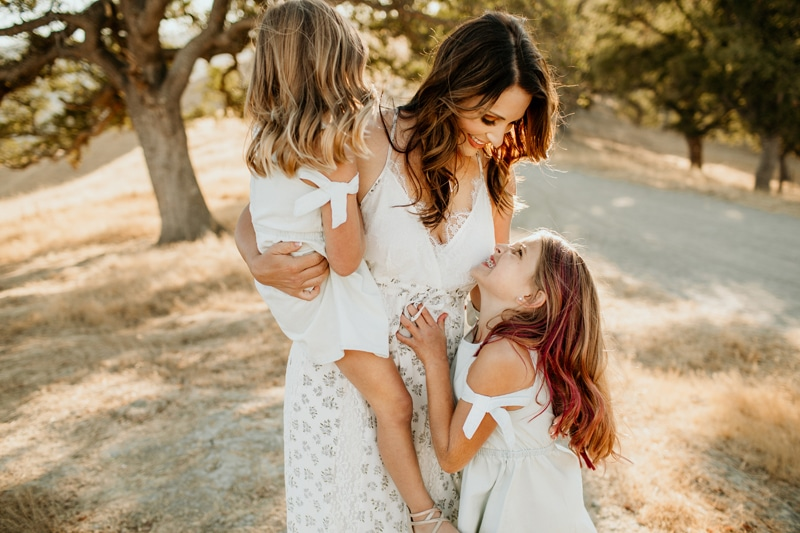 Family Photography, mother smiling with daughters