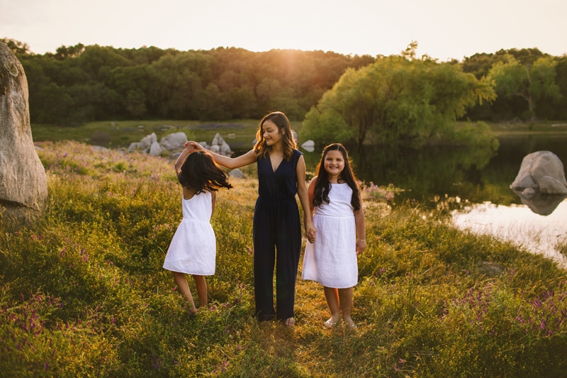 Family Photography, three girls standing next to lake