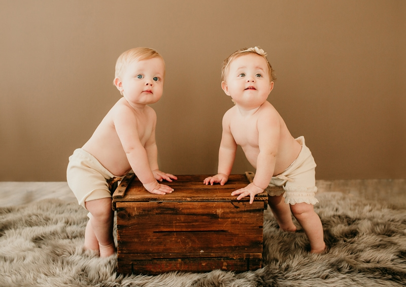 Baby Photography,  babies standing up against a wooden crate