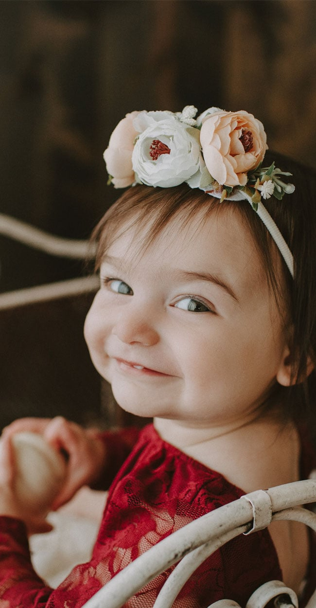 Baby Photography, little girl with flower crown looking toward the camera