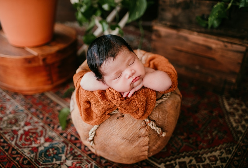 Newborn Photography, baby asleep in a little round basket